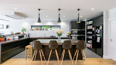 Different flooring helps emphasise the different zones in the open-plan area (photo: Savills)