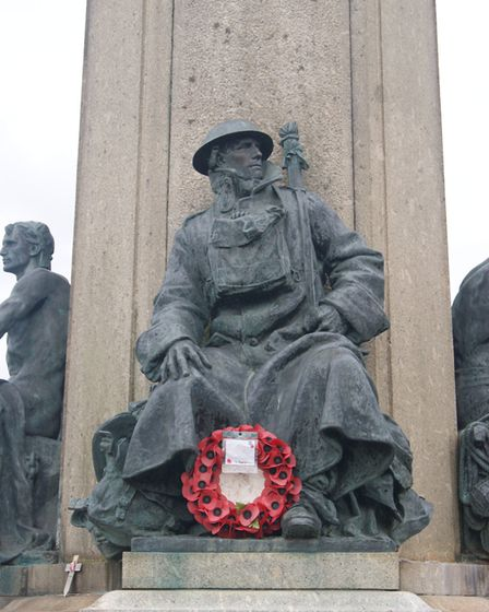 A statue of a First World War soldier on the base of the Exeter City War Memorial