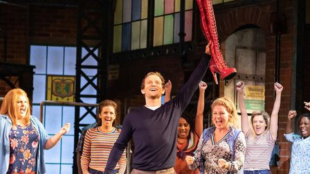 Joel Harper-Jackson, as Charlie, has the solution to his factory's troubles, in Kinky Boots Manchest