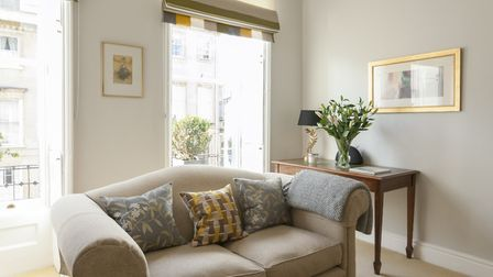 The second Laura Ashley sofa by the window with blinds sewn by Judith Payne using fabric from the Ho