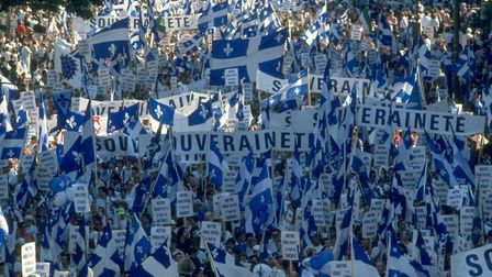 Pro-independence Quebeckers in sea of banners & fleur-de-lis flags. Picture: Steve Liss/The LIFE Ima