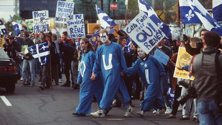 Last YES rally before the referendum: people carry signs and the flag of Quebec. Picture: Getty Imag