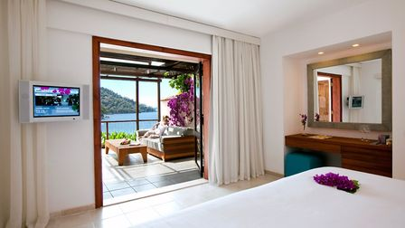 One of the beautiful, lofty rooms with its own private terrace overlooking the bay