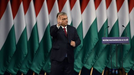 Hungarian Prime Minister Viktor Orban waves after his annual state of the nation speech. Picture: AT