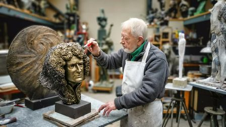 John working on the head of Brian May (photo: Chris Frazer Smith)