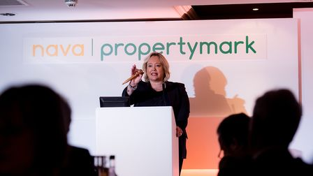 Auctioneer Deborah Latham at the Property Mark event receiving her coveted award. Photo by Dave Perr