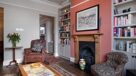 The sitting room is one of Jamie's favourite rooms, made comfortable by a Laura Ashley leather chair