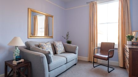 The sofa in the second bedroom converts to a bed when guests come to stay. The carpet is Cheviot Bre
