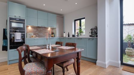 The Leicht cabinetry, painted in Ral Design 1907010, and the White Storm silestone worktops were des