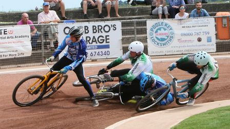 Exeter Aces' riders Rob Geach and Aaron Herbert (in green) and their opponents from Poole tangle on