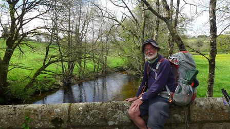 John Sutcliffe takes a breather on Dartmoor during his epic walk to mark his 70th birthday