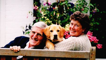 Jimmy, Charlie and Bryony Hill at home on a garden bench