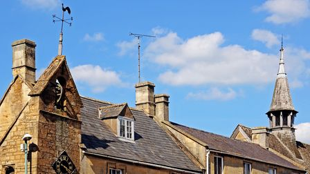 Architectural detail on town centre buildings, including the decorate curfew tower on the corner of