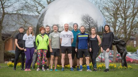 Kieron Fosher, centre in white T-shirt, in Kings Hill with members of the free social run group he's
