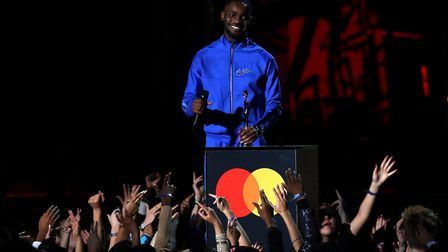 Dave with his Mastercard Album of the Year award on stage at the Brit Awards 2020 at the O2 Arena, London. Photograph...