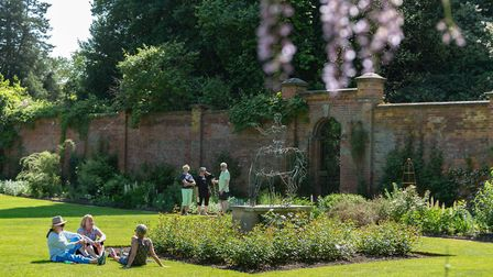 Visitors in the Walled Garden at Hare Hill (c) National Trust
