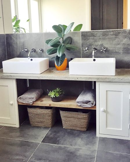 His and hers sinks and mirrored wall in the bathroom has an elegant symmetry and makes for quicker m