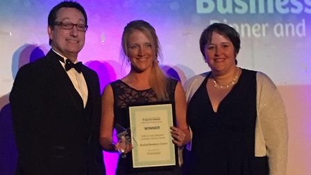 Jenna Paynter (centre) receiving the award from Anne Marie Thurgood, Cirencester Chamber of Commerce