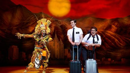 M-Jae Cleopatra Isaac, Kevin Clay and Conner Peirson in The Book of Mormon. Manchester Palace Theatr