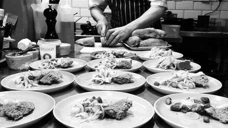 Nick Leonard prepares dishes in the kitchens of ethical restaurant and wine bar Farmyard in Saint Le