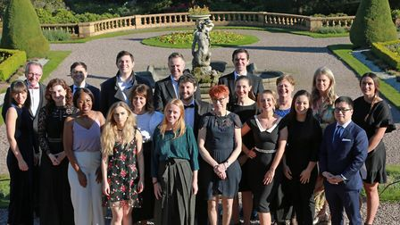 The Hope for Justice staff and volunteers with Tatton's gardens as a backdrop