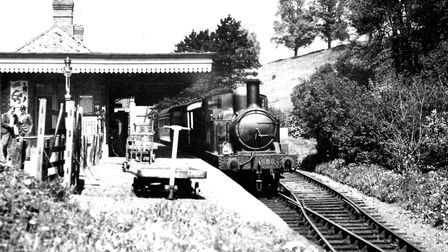 An ex-GWR 0-4-2 tank loco, known locally as 'The Donkey', pulls into Tetbury a few months after nati