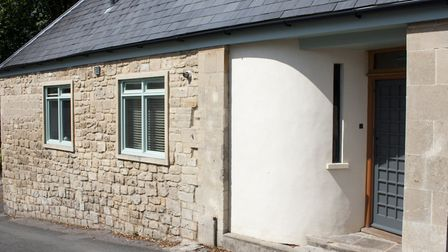 Sarah's cosy-looking cottage began as stables for the big house next door. It is much bigger now aft