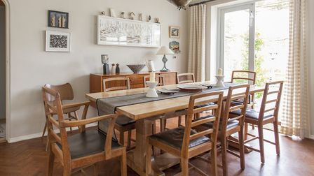 The oak table and chairs came from Heals and cost £2,000 at an auction. The candle sticks are by Anj