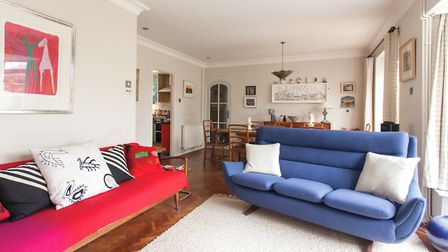 The blue Parker Knoll sofa came via eBay, all the way from Glasgow. Sarah recovered it in a vibrant