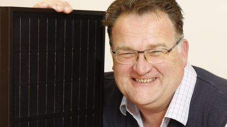 Ben Harrison, managing partner of mypower, with a small section of a larger solar panel.