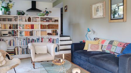 There is a sizeable drop from the kitchen to the lower level sitting room, so their builder turned t