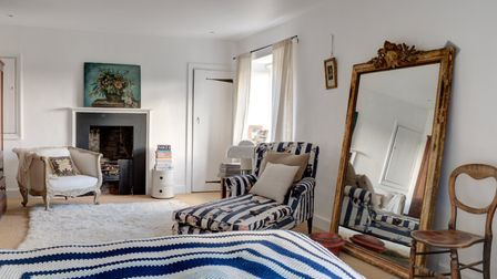 Liz's grandmother crocheted the pretty bedspread many years ago. The elm floorboards were a lovely f