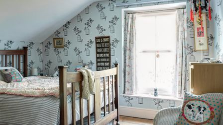 In Marina's bedroom and in the other two bedrooms, Max sanded the floorboards. The eco-wallpaper is