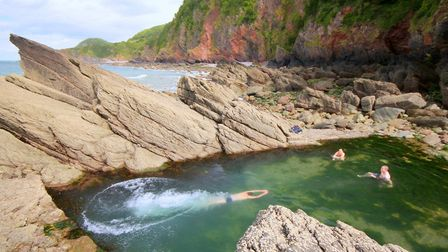 A tidal swimming pool lies in wait at Woody Bay