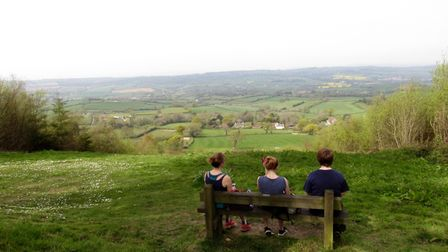 Three runners pause to admire the fabulous view from White Cross