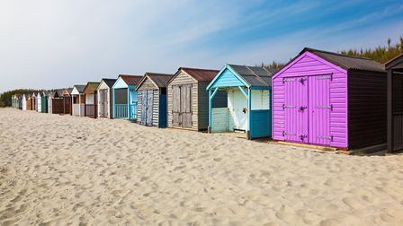 Traditional beach huts on fine golden sand at West Wittering (ian woolcock/Getty Images/iStockphoto)