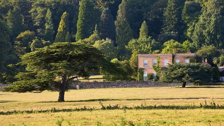 The Killerton House estate turns a warm shade of rustic red, golden brown, and yellow in the autumn