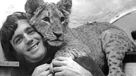 John Rendall pictured with his shop-bought lion cub which inspired a lifetime of conservation in a p