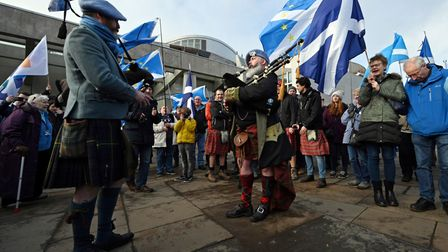 Bagpipe players attend an anti-Conservative government, pro-Scottish independence, and anti-Brexit demonstration
