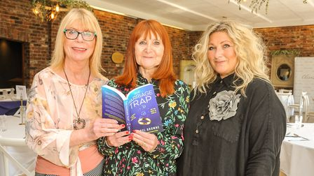 Author Sheryl Browne reading her latest book 'The Marriage Trap with Sue France organiser of the eve