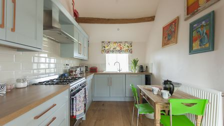Oak cabinetry and wood worktops from Howdens went into the kitchen, then Sarah painted it in 'Fondan