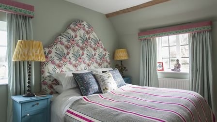 The walls in the main bedroom are painted in 'Sage Brush' by Benjamin Moore. The design on the flowe