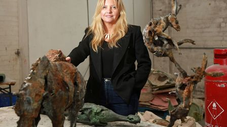 Emma Rogers with some of her works
