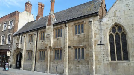 The Crypt Grammar School's original location next to St Mary de Crypt church. Henley attended the sc