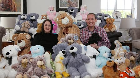 Award-winning Dee Drake with husband Chris Drake (and Oscar the dog) surrounded teddies for the Toy