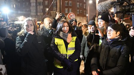 Mayor of Paris Anne Hidalgo walk with police forces evacuating migrants early morning in Paris. (Pho