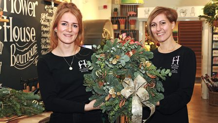 Megan Palmer and Bev Coghlan and their Christmas wreaths at The Flower House, Macclesfield