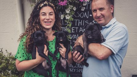 Alice and Troy Bryant with their pugs Ronnie and Rosa