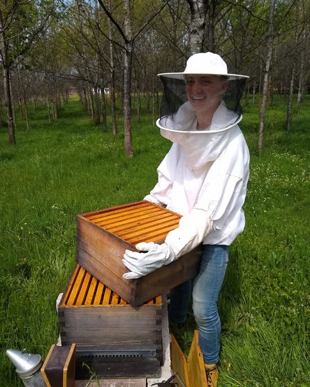 Volunteering has meant taking all kinds of jobs, including beekeeping
