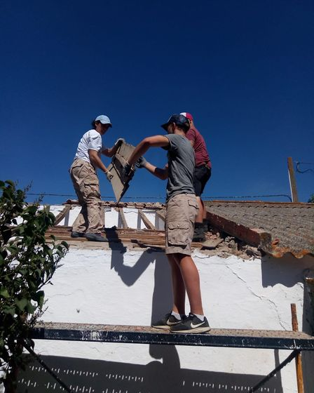 Taking a roof off a farmhouse before replacing it